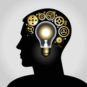 silhouette of a man's head with a glowing light bulb, and gears.